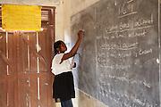 A female teacher taking a lesson at Tonga Junior High School, Ghana.