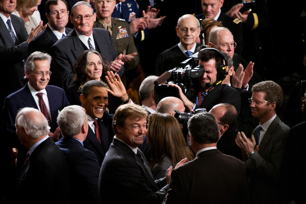 President Barack Obama waves to First Lady Michelle Obama as he arrives for his State of the Union address in the U.S. Capitol on Tuesday, January 24, 2012 in Washington, DC.