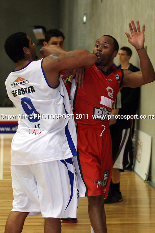 Saints Corey Webster and Pistons Jerry Smith  fighting for the ball during their their NBL Game at  Hamilton,Basketball,Pistons Vs Saints, Wednesday 4 May 2011.<br /> Photo: Dion Mellow / photosport.co.nz