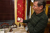Rev. John Eaton holds a goose egg with a nativitiy scene made from a single wire at the Meredith Bay Colony Club on Frlday afternoon.  (Karen Bobotas/for the Laconia Daily Sun)