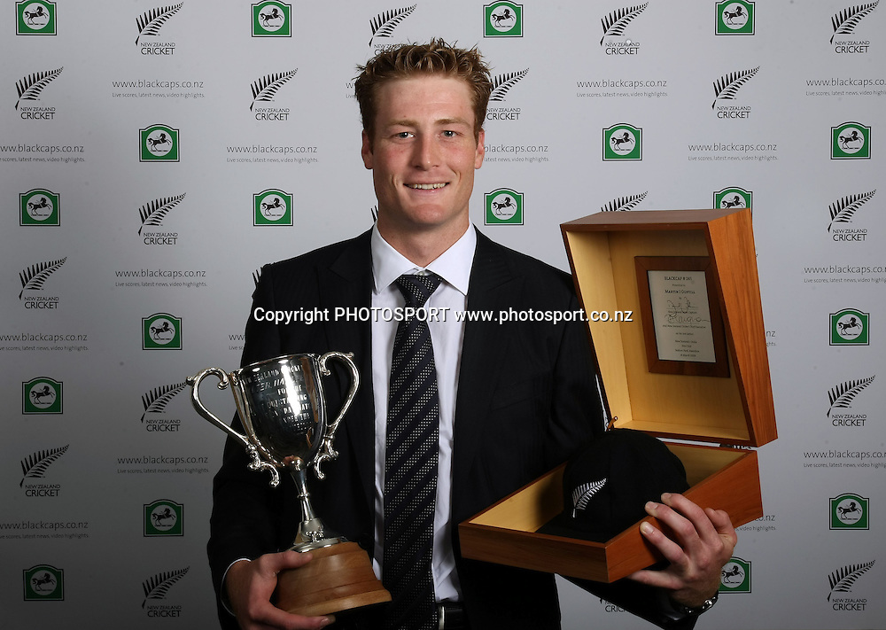 Martin Guptill with the Walter Hadlee Trophy and his Black Cap.<br />New Zealand Cricket Awards for the 2008/09 season at the Sky City Grand Hotel in Auckland on Thursday 22 October 2009. Photo: Andrew Cornaga/PHOTOSPORT