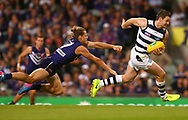 PERTH, AUSTRALIA - MARCH 26: Patrick Dangerfield of the Cats breaks clear of a tackle by Nathan Fyfe of the Dockers during the round one AFL match between the Fremantle Dockers and the Geelong Cats at Domain Stadium on March 26, 2017 in Perth, Australia.  (Photo by Paul Kane/Getty Images) *** Local Caption *** Patrick Dangerfield; Nathan Fyfe