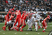 The Kansas City Chiefs leap while trying to block a first quarter extra point that gives the Oakland Raiders a 7-3 lead during the 2017 NFL week 7 regular season football game against the against the Oakland Raiders, Thursday, Oct. 19, 2017 in Oakland, Calif. The Raiders won the game 31-30. (©Paul Anthony Spinelli)