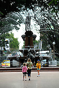Mother and daughters (6 years old, 10 years old) beside the Archibald Fountain. Designed by François Sicard, the fountain was donated by J.F. Archibald in 1932 in honour of Australia's contribution to the Great War in France. Hyde Park, Sydney, Australia