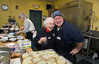 Faith Levesque and Roger Caron prep the desserts for their guests for the Hands Across the Table dinner at St Andre Bassette Parish Hall held on Wednesday evenings.  (Karen Bobotas/for the Laconia Daily Sun)