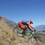 Jarrah Healy from Queenstown in action during the New Zealand South Island Downhill Cup Mountain Bike series held on The Remarkables face with a stunning backdrop of the Wakatipu Basin. 150 riders took part in the two day event. Queenstown, Otago, New Zealand. 9th January 2012. Photo Tim Clayton