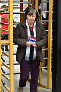 Grimsby Town fan arrives through the turnstiles before the EFL Sky Bet League 2 match between Grimsby Town FC and Oldham Athletic at Blundell Park, Grimsby, United Kingdom on 15 September 2018.