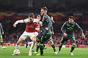 Arsenal Midfielder Aaron Ramsey (8) and Sporting Lisbon Defender Andre Pinto (6) during the Europa League group stage match between Arsenal and Sporting Lisbon at the Emirates Stadium, London, England on 8 November 2018.