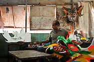 Jose Manuel Sanoja, artesano de mascaras. La festividad del Corpus Christi es una celebración conocida en Venezuela a través del ritual mágico-religioso de los Diablos Danzantes de Yare, que se celebra desde el siglo XVIII en San Francisco de Yare, en el estado Miranda. Cada jueves de Corpus Chirsti se hace una danza ritual de los llamados diablos, los cuales visten trajes coloridos (completamente de rojo), capas y máscaras de apariencia grotesca, además de adornos como cruces, escapularios, rosarios y otros amuletos, 08-06-2011. (ivan gonzalez)