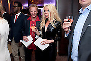 MIKAEL ERLANDSSON; JENNY RADENKVIST, The London Bar and Club awards. Intercontinental Hotel. Park Lane, London. 6 June 2011. <br /> <br />  , -DO NOT ARCHIVE-© Copyright Photograph by Dafydd Jones. 248 Clapham Rd. London SW9 0PZ. Tel 0207 820 0771. www.dafjones.com.
