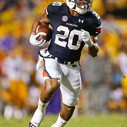 Sep 21, 2013; Baton Rouge, LA, USA; Auburn Tigers running back Corey Grant (20) runs against the LSU Tigers during the second half of a game at Tiger Stadium. LSU defeated Auburn 35-21. Mandatory Credit: Derick E. Hingle-USA TODAY Sports