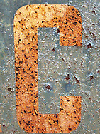 detailed image of letters on rusty sign