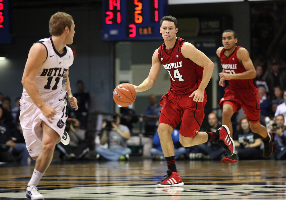 November 19, 2011: Louisville's Kyle Kuric moves the ball up the court against Butler at Hinkle Fieldhouse in Indianapolis, Ind. Louisville won 69-53.