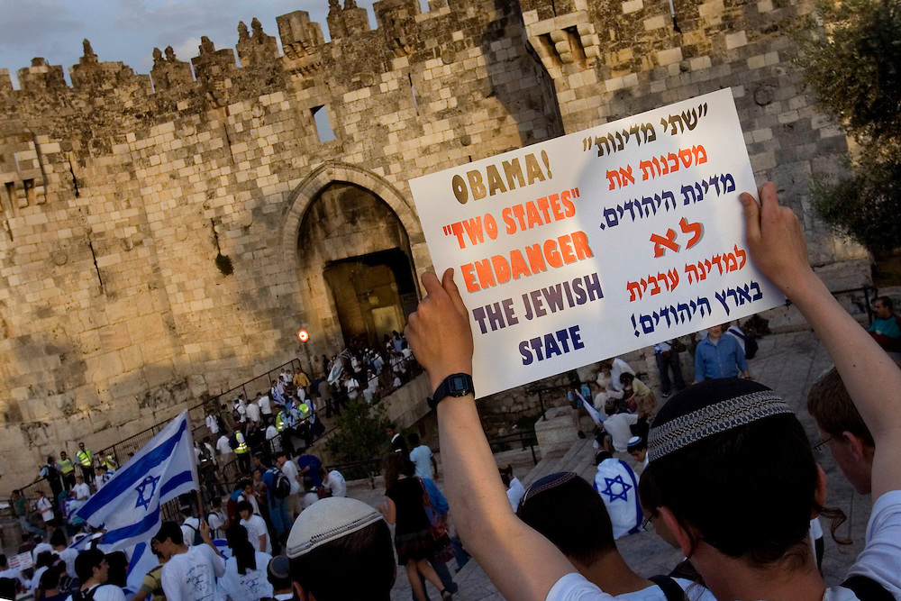 An Israeli youth holds a sign protesting U.S. President Barack Obama's call for a two-state solution to the Palestinian-Israeli conflict during a parade marking Jerusalem Day in front of the Damascus Gate in Jerusalem's Old City May 21, 2009. Jerusalem Day marks the anniversary of Israel's capture of the Arab Eastern part of the city. Israel annexed East Jerusalem as part of its capital in the 1967 Middle East War in a move not recognized internationally. Photo by Olivier Fitoussi /ABACAUSA.COM