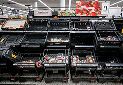 © Licensed to London News Pictures. 05/03/2020. London, UK. Empty shelves on the tomato aisle. Panic-buying continues to show in a South West London ASDA store as shelves empty out of goods as Prime Minister Boris Johnson appears on This Morning TV show to reassure the public that the Government is doing all it can to fight the coronavirus disease.. Photo credit: Alex Lentati/LNP