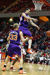 30 January 2007: Bradley Strickland goes high for a rebound, but Matt Websters' shot bounds away. The Purple Aces of Evansville folded the final 2 minutes of play and handed the game to Illinois State University Redbirds by a score of 65-61at Redbird Arena in Normal Illinois.