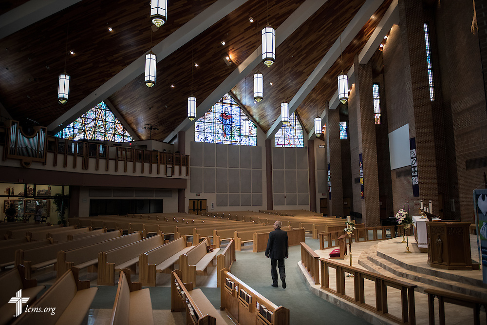 The Rev. Wally Arp, senior pastor of St. Luke's Lutheran Church, walks through the empty sanctuary before a wedding on Saturday, March 5, 2016, in Oviedo, Fla. LCMS Communications/Erik M. Lunsford