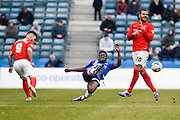 Gillingham defender Adedeji Oshilaja wins the ball in midfield ahead of Coventry forward Adam Armstrong during the Sky Bet League 1 match between Gillingham and Coventry City at the MEMS Priestfield Stadium, Gillingham, England on 2 April 2016. Photo by David Charbit.