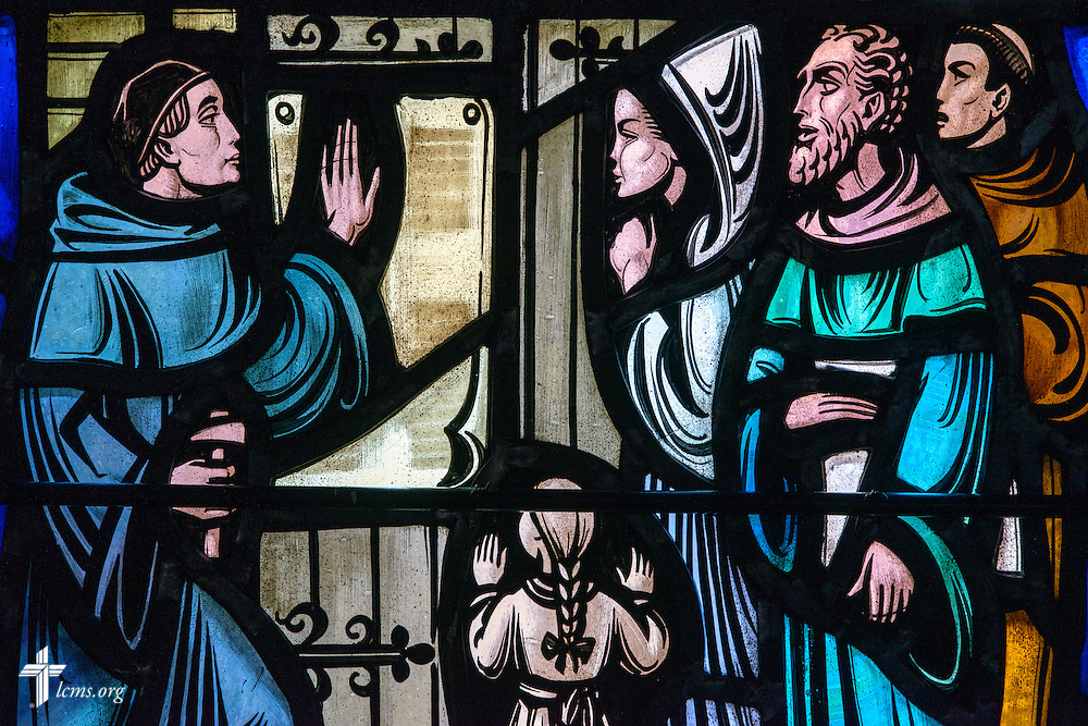 Stained glass at Luther Memorial Chapel depicts Martin Luther nailing the 95 Theses to the Wittenberg Castle church door, on Friday, Jan. 29, 2016, in Shorewood, Wis. LCMS Communications/Erik M. Lunsford