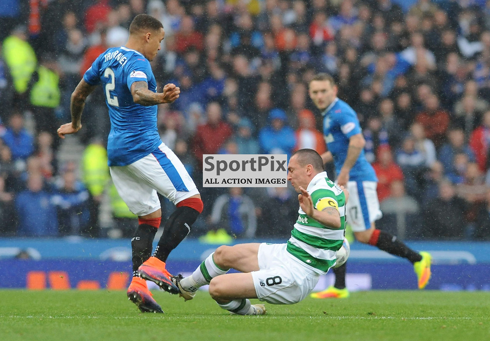 Scott Brown slides in to tackle James Tavernier in the match between Rangers v Celtic, Betfred Cup semi-final, Hampden Park, Sunday 23 October 2016, (c) Angie Isac | SportPix.org.uk