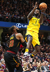 April 25, 2018 - Cleveland, OH, USA - The Indiana Pacers' Lance Stephenson scores over the Cleveland Cavaliers' LeBron James during the second quarter in Game 5 of a first-round playoff series on Wednesday, April 25, 2018, at Quicken Loans Arena in Cleveland. (Credit Image: © Leah Klafczynski/TNS via ZUMA Wire)