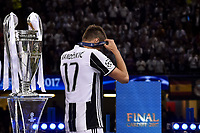Mario Mandzukic of Juventus is dejected and walk by the Champions League Trophy during the UEFA Champions League Final match between Real Madrid and Juventus at the National Stadium of Wales, Cardiff, Wales on 3 June 2017. Photo by Giuseppe Maffia.<br /> <br /> Giuseppe Maffia/UK Sports Pics Ltd/Alterphotos
