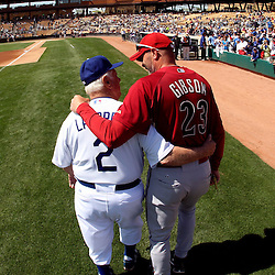Los Angeles Dodgers former manager Tommy Lasorda and former Dodger great and current Arizona Diamondbacks bench coach Kirk Gibson (23) share a moment before a game at the Ballpark at Camelback Ranch on Wednesday, March 10, 2010, in Glendale,Arizona.