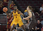 Nov 22, 2017; Los Angeles, CA, USA; Southern California Trojans forward Chimezie Metu (4) is defended by Lehigh Mountain Hawks center James Karnik (13) during an NCAA basketball game at Galen Center. USC defeated Lehigh 88-63.