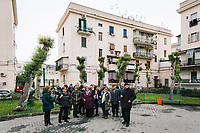 """NAPLES, ITALY - 2 FEBRUARY 2019: Passengers of the literary bus tour """"Neapolitan Novels"""" are seen here in the Rione Luzzatti, the neighborhood in which Elena Ferrante's """"My Brilliant Friend"""" is set, in Naples, Italy, on February 2nd 2019.<br /> <br /> In December 2018, City Sightseeing - the world's largest sightseeing tour bus operator - inaugurated the """"Brilliant Naples"""" tour, inspired by the locations in """"Neapolitan Novels"""", a 4-part series by the Italian novelist Elena Ferrante. The series has sold over 10 million copies in 40 countries. The first book in the series has also been adapted into an HBO television series entitled, """"My Brilliant Friend."""""""