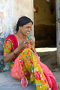 Young Indian Hindu girl age 20 sewing bridal veil at home in Tarpal in Pali District of Rajasthan, Western India