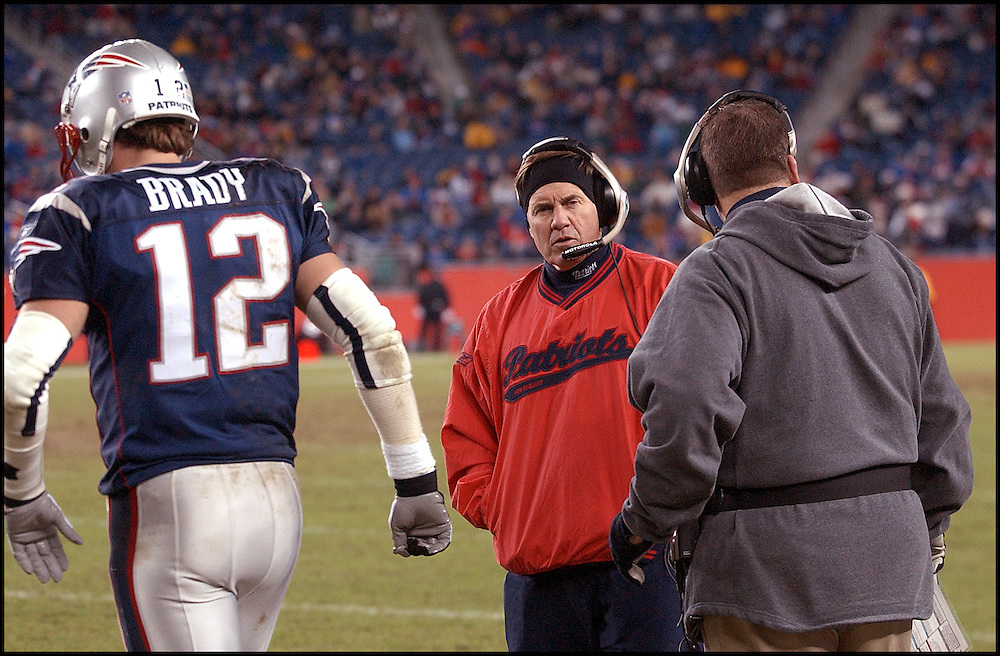 (12/22/02 Foxboro, MA) New England Patriots vs The New York Jets. Head coach bill Belichick looks to offensive coordinator Charlie weis as Tom Brady heads back into the game after the pats final timeout on the final drive of the game.  (122202patsmjs-staff photo  by Michael Seamans. Saved in photo Mon/cd. )