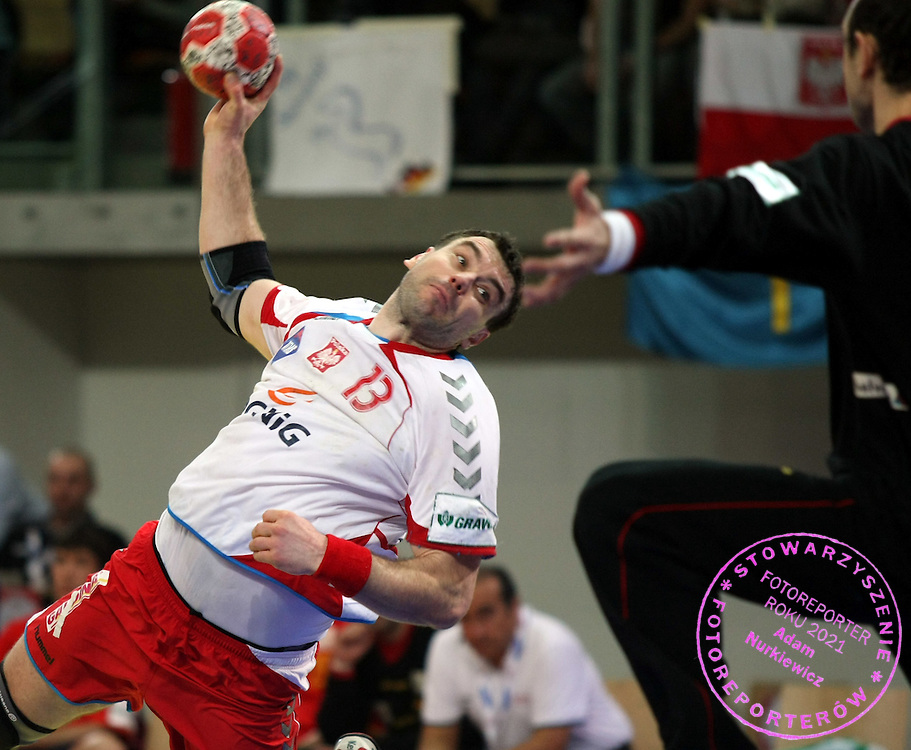 GEPA-24011079120 - INNSBRUCK,AUSTRIA,24.JAN.10 - SPORT DIVERS, HANDBALL - EHF Europameisterschaft, EURO 2010, Laenderspiel, Polen vs Spanien. Bild zeigt Bartosz Jurecki (POL). Foto: GEPA pictures/ Amir Beganovic.FOT. GEPA / WROFOTO.*** POLAND ONLY !!! ***