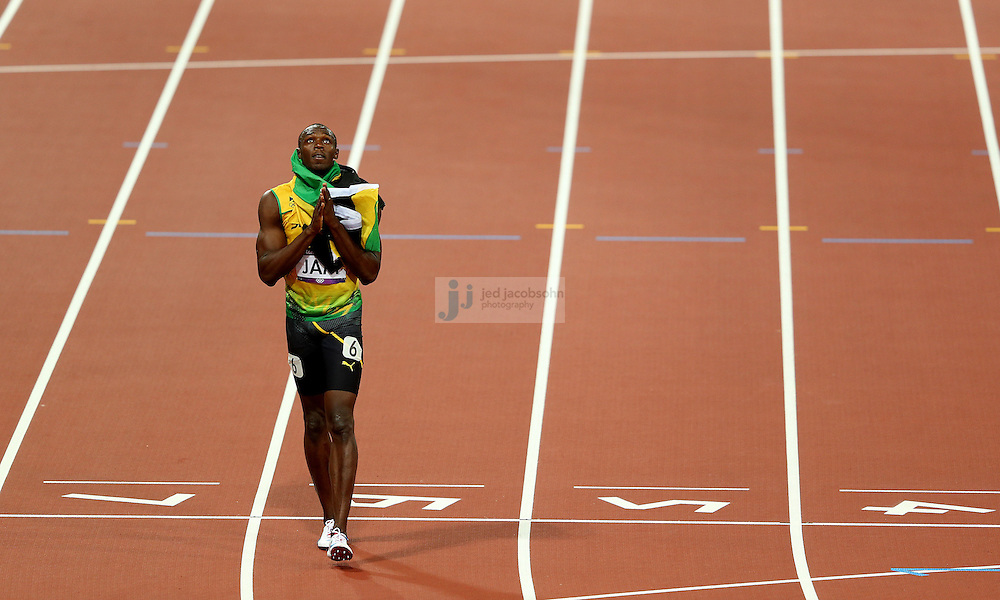 Usain Bolt of Jamaica celebrates after winning the men's 4x100 relay race at the Olympic stadium during day 15 of the London Olympic Games in London, England, United Kingdom on August 11, 2012..(Jed Jacobsohn/for The New York Times)..