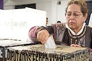 Mujer que deposita su voto en la urna electoral election, elección, elections, elecciones, votacion, 2012, july, julio, democracy, politics, política, democracia, jornada, ciudadanía, ciudadano, citizenship, citizen, participación, lucha, sistema, system