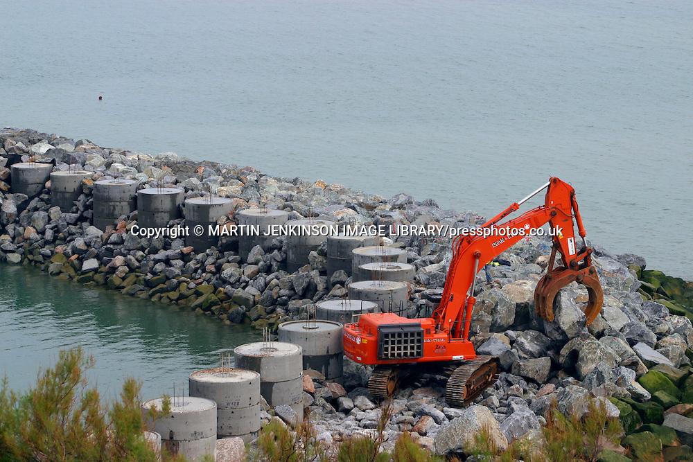 Building a new groyne to prevent coastal erosion using large rocks, Folkstone.