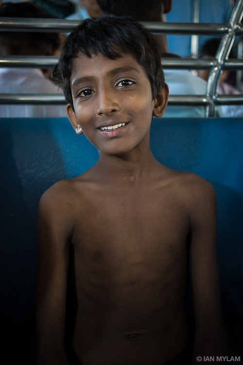 Boy on a Train - Mumbai, India, 2013