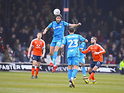 Barnet captain Dan Sweeney wins a high ball in the first half during the EFL Sky Bet League 2 match between Luton Town and Barnet at Kenilworth Road, Luton, England on 24 March 2018. Picture by Ian  Muir.during the EFL Sky Bet League 2 match between Luton Town and Barnet at Kenilworth Road, Luton, England on 24 March 2018. Picture by Ian  Muir.