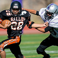 11031313    Brian Leddy<br /> Gallup Bengal Darius Stewart (28) breaks free from Miyamura Patriot Jeremiah Salas (88) tackel during Saturday's game at Public School Stadium