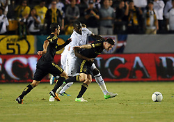 24 July 2012: Tottenham Hotspur (19) Sebasten Bassong holds off Galaxy (7) Robbie Keane during an international friendly soccer match between Tottenham Hotspur and the Los Angeles Galaxy at the Home Depot Center in Carson, CA.