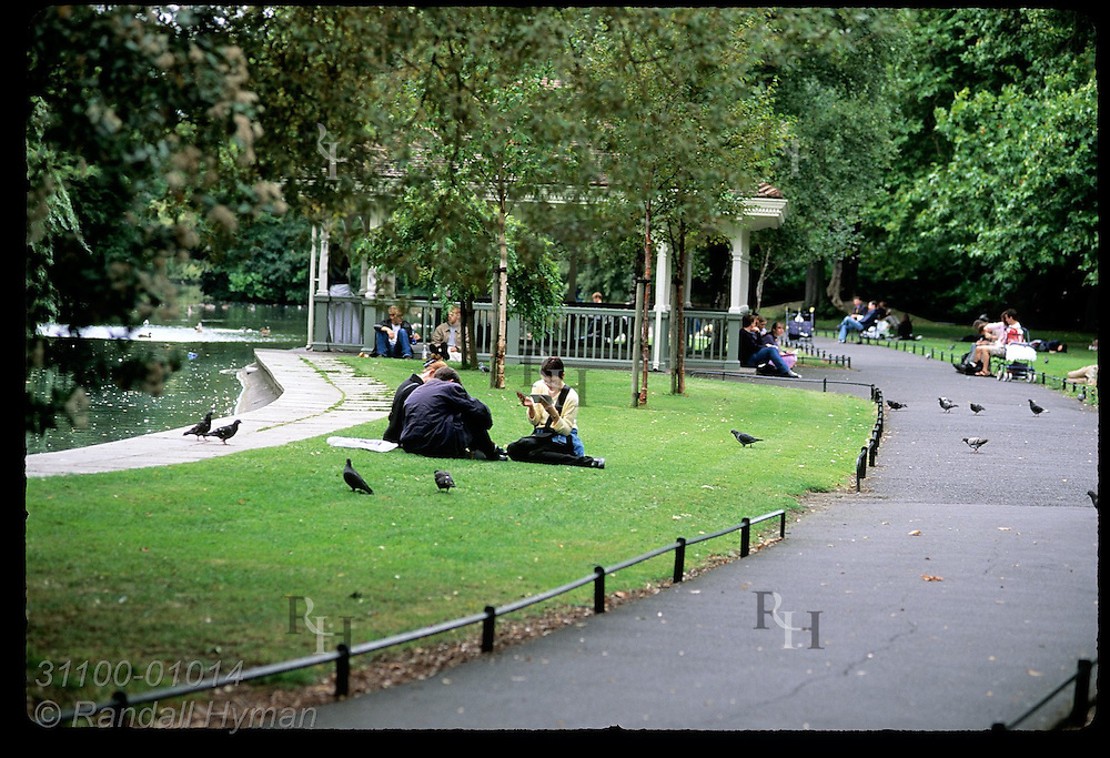 People relax on lawn and benches at St. Stephen's Green on a September afternoon; Dublin, Ireland.