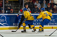 KELOWNA, BC - DECEMBER 18: Referee Steve Papp stops at the boards during the game between Team Sweden and Team Russia at Prospera Place on December 18, 2018 in Kelowna, Canada. (Photo by Marissa Baecker/Getty Images)***Local Caption***