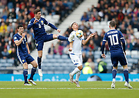 Football - 2018 / 2019 UEFA European Championship Qualifier - Group I: Scotland vs. Cyprus<br /> <br /> Kenny McLean of Scotland vies with Pieros Sotiriou of Cyprus during the European Championship Qualifying match between Scotland and Cyprus, at Hampden Park, Glasgow.<br /> <br /> COLORSPORT/BRUCE WHITE