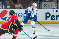 PENTICTON, CANADA - SEPTEMBER 10: Olli Juolevi #48 of Vancouver Canucks passes the puck past Dillon Dube #59 of Calgary Flames on September 10, 2017 at the South Okanagan Event Centre in Penticton, British Columbia, Canada.  (Photo by Marissa Baecker/Shoot the Breeze)  *** Local Caption ***
