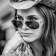 Monochromatic portrait of young woman in a cowboy hat.