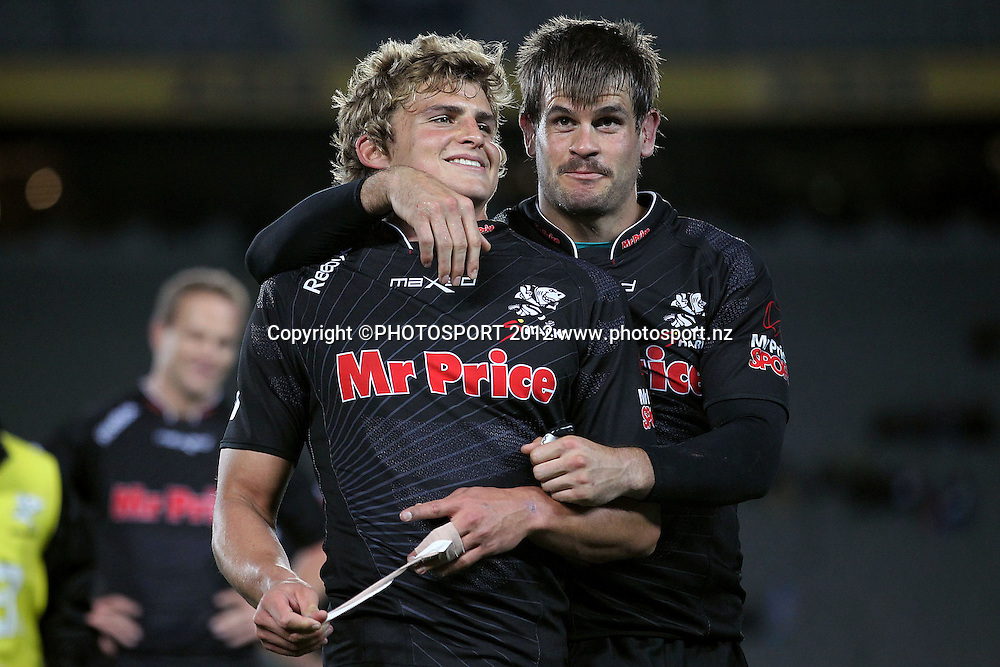 Sharks' Patrick Lambie and Louis Ludik shares a laugh after the win. Super Rugby rugby union match, Blues v Sharks at Eden Park, Auckland, New Zealand. Friday 13th April 2012. Photo: Anthony Au-Yeung / photosport.co.nz