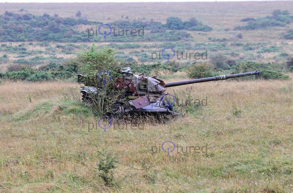 Wrecked tanks on Salisbury Plain firing ranges, Imber village British Army Urban warfare training area, Salisbury Plain, Wiltshire UK, 25 August 2014, Photo by Richard Goldschmidt