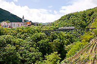Ticino, Southern Switzerland. Local train on the viaduct approaching Intragna.