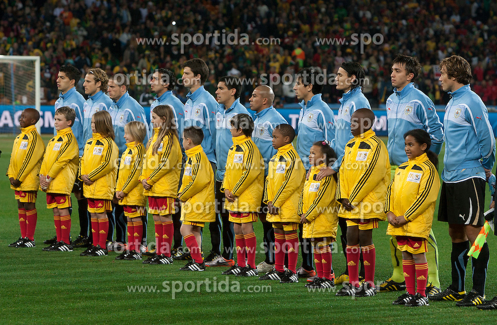 Players of Uruguay listening to the national anthem during the 2010 FIFA World Cup South Africa Quarter Finals football match between Uruguay and Ghana on July 02, 2010 at Soccer City Stadium in Sowetto, suburb of Johannesburg. Uruguay defeated Ghana after penalty shots. (Photo by Vid Ponikvar / Sportida)