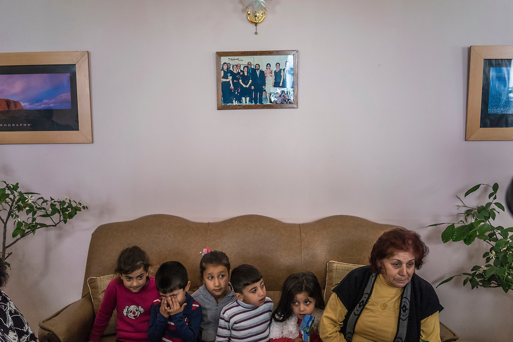 A family displaced by recent fighting from the city of Martakert is interviewed by foreign journalists at the hotel where they are temporarily being housed on Monday, May 9, 2016 in Stepanakert, Nagorno-Karabakh.