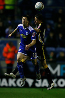 Photo: Steve Bond.<br /> Leicester City v Cardiff City. Coca Cola Championship. 26/11/2007. Matty fryatt (L) tries to get the ball in the air agains  Chris Gunter (R)